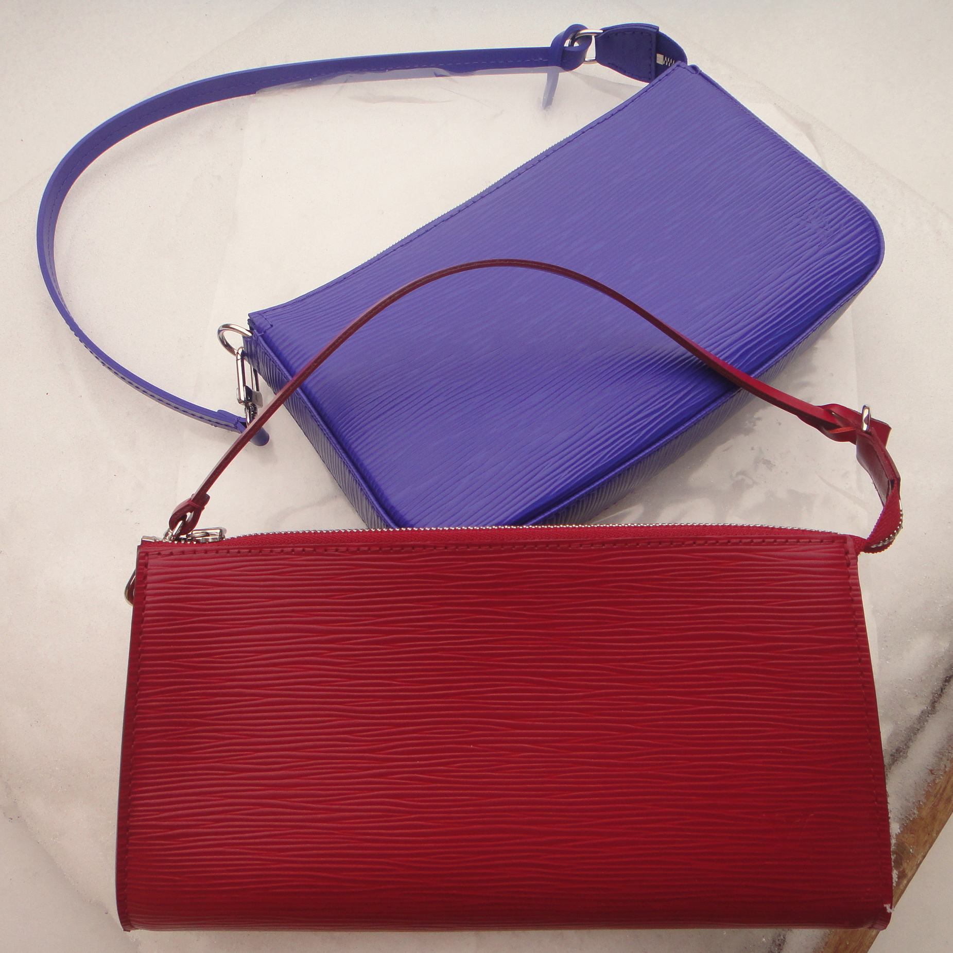 LV Pochette Accessoires top   NEW MODEL in FIGUE, bottom OLD MODEL in FUCHSIA