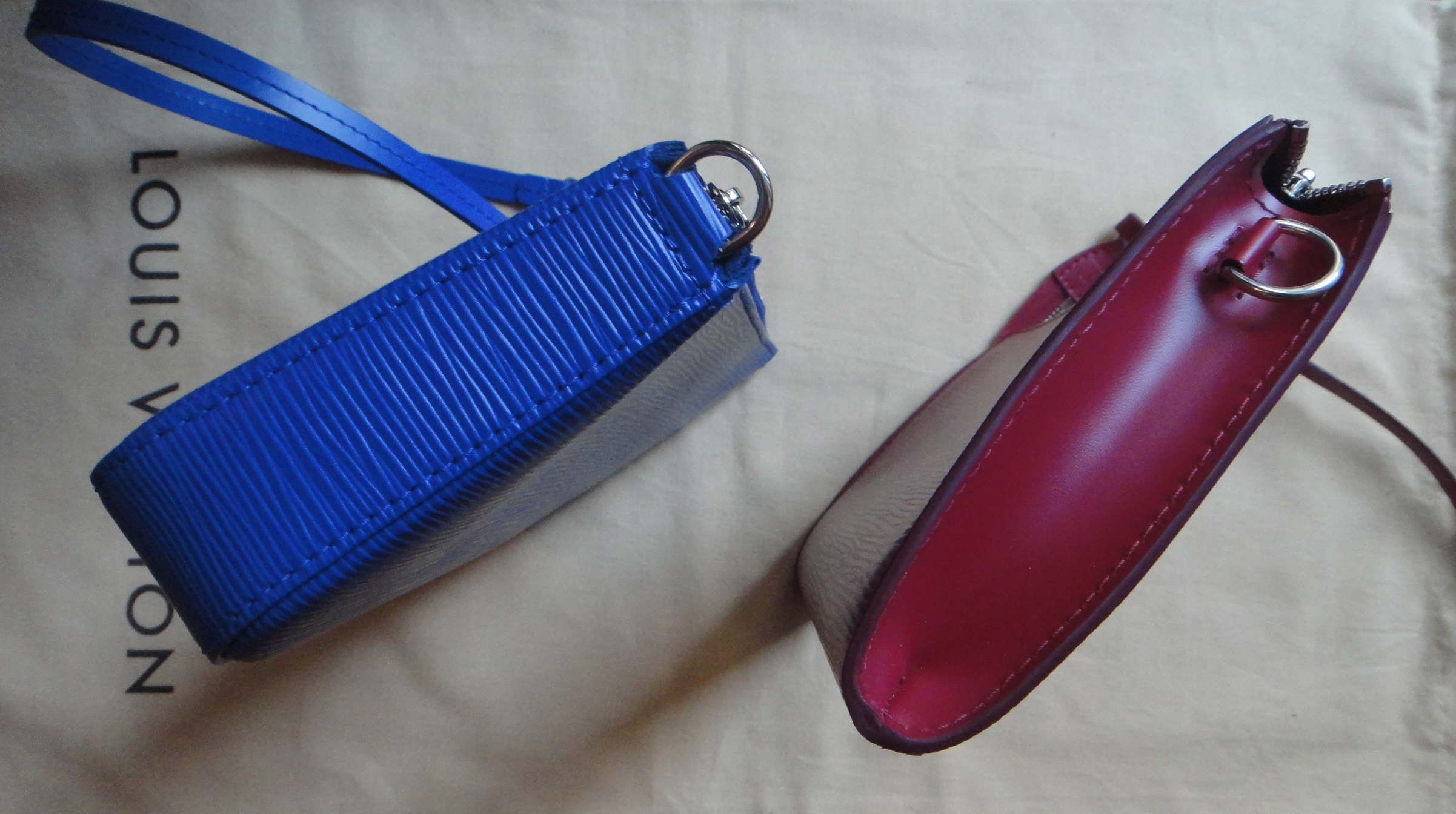 LV Pochette Accessoires left: NEW MODEL in FIGUE, right: OLD MODEL in FUCHSIA