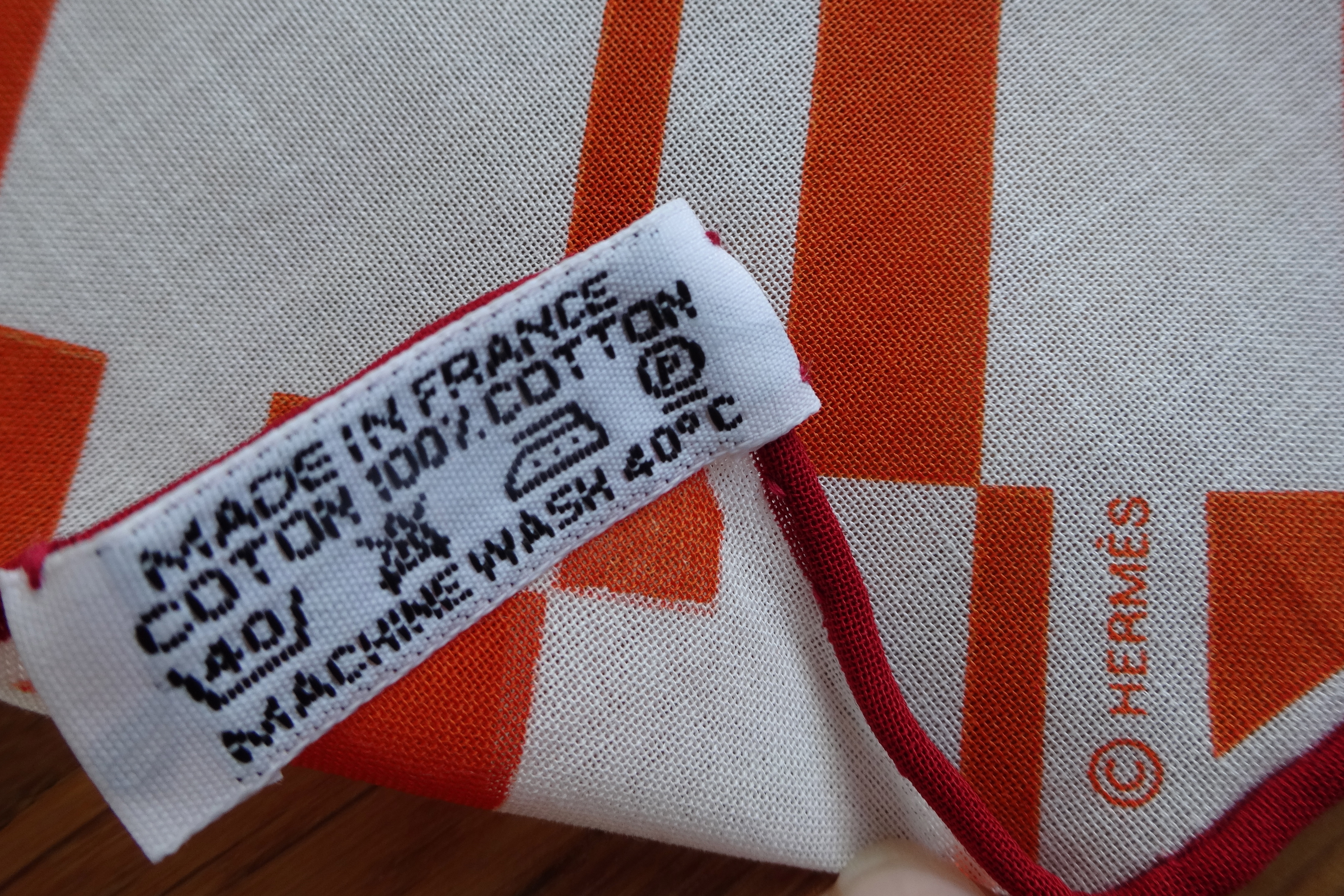 Hermès care tag and (c) mark