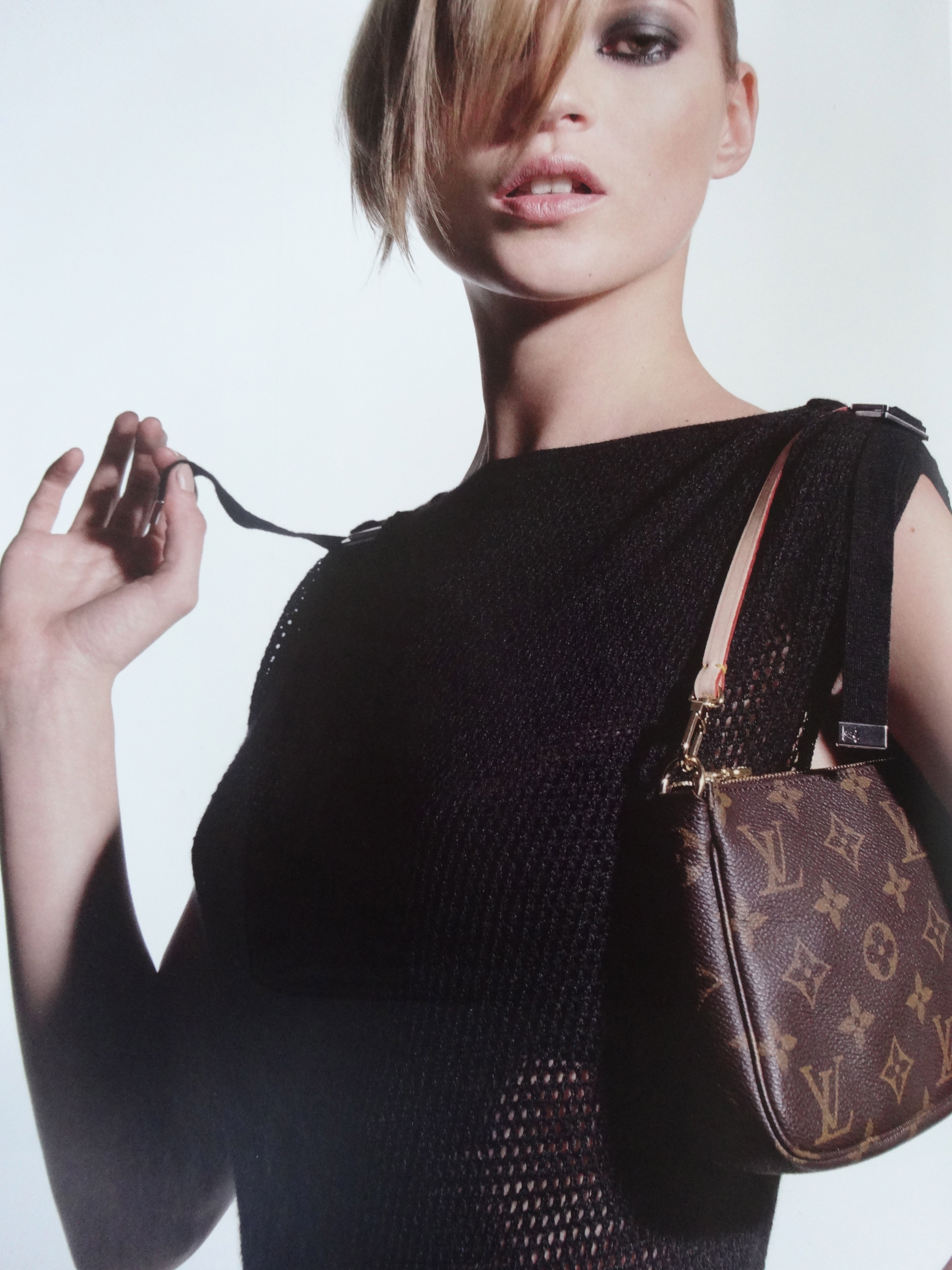 Kate Moss with Pochette Accessoires, ad 2001, (c) Louis Vuitton