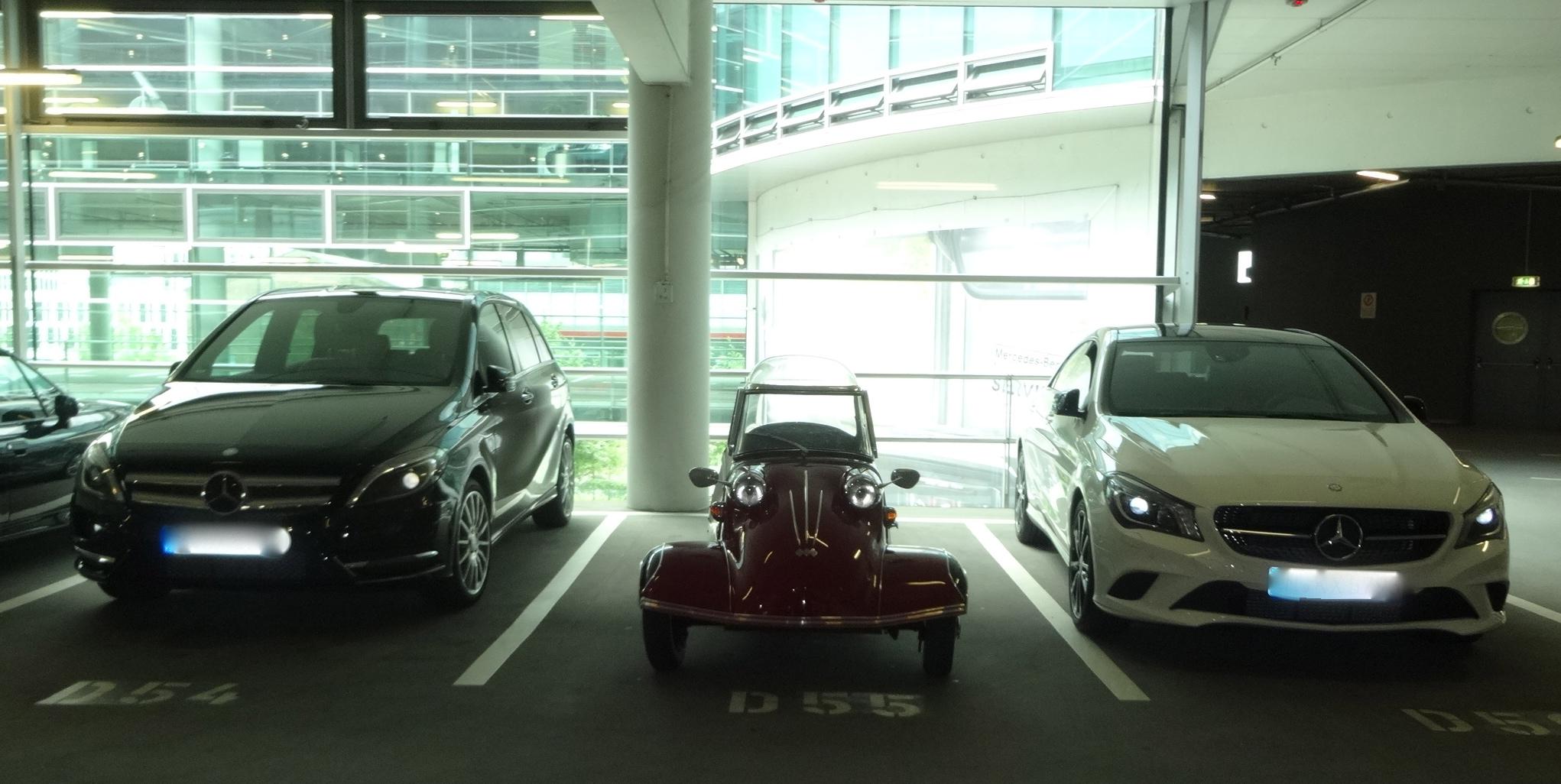 a Messerschmitt 3-wheeler between two large Mercedes cars