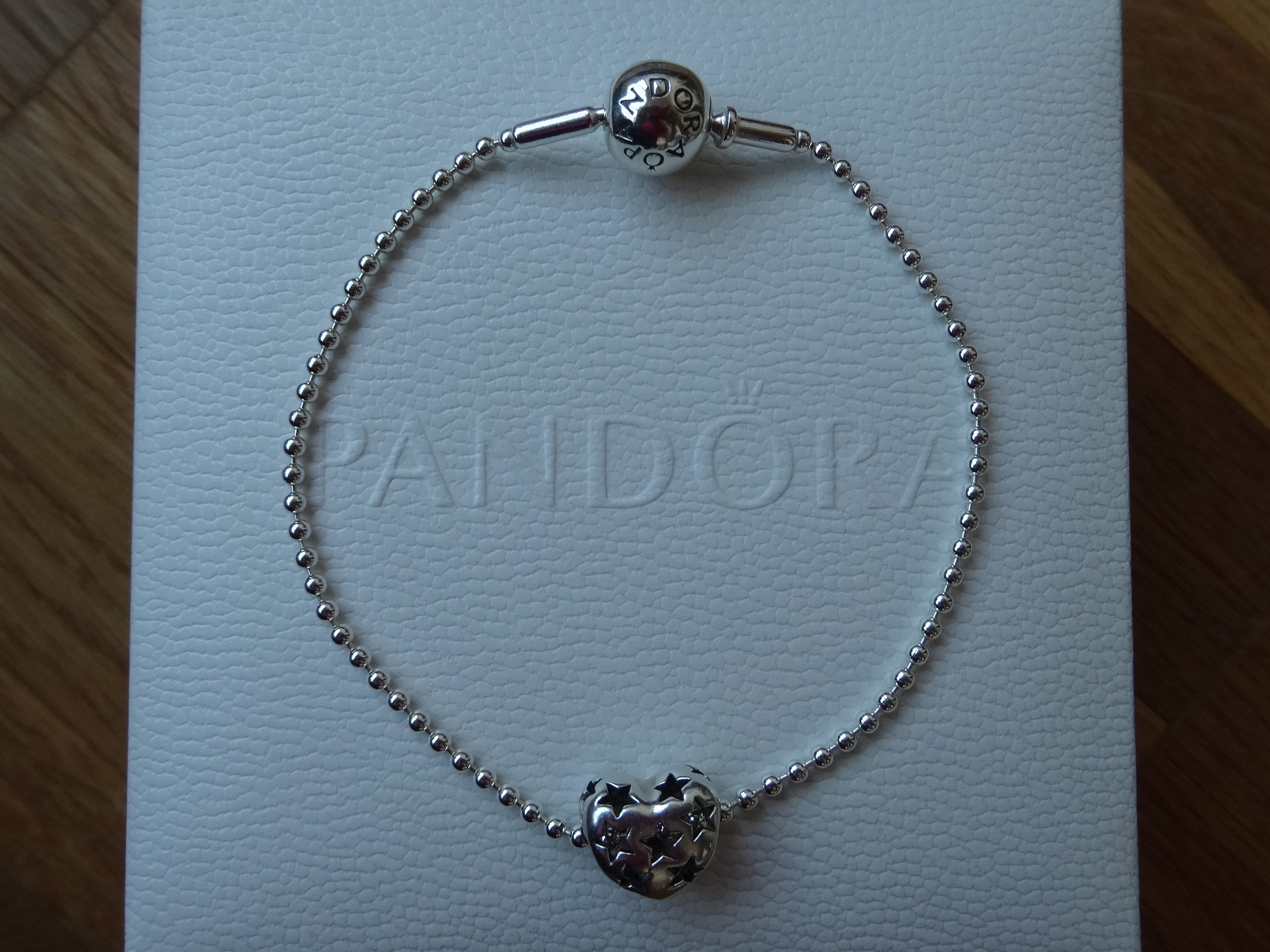 Pandora Essence bracelet with open work heart bead