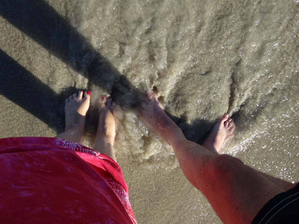 the water washing the sand beneath our feet away...