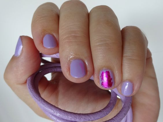 wisteria colored nail polish and matching bracelet