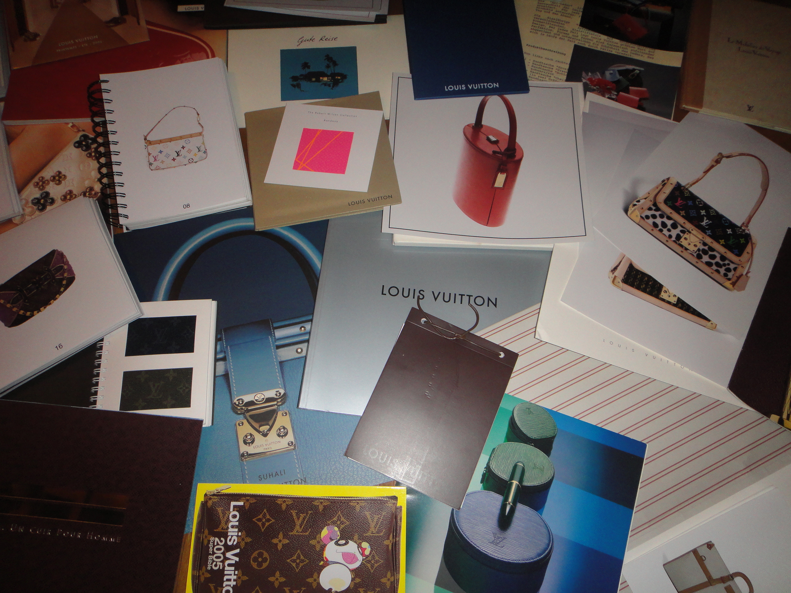 selection of Louis Vuitton brochures