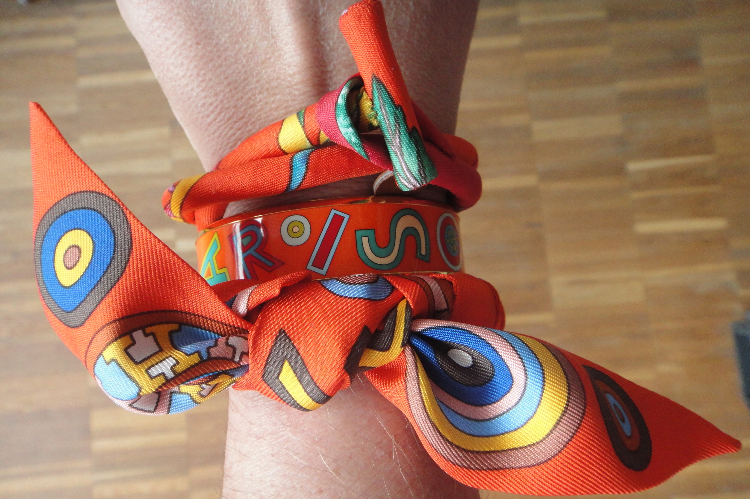 going a bit crazy on Hermès silk bracelets with enamel bangle