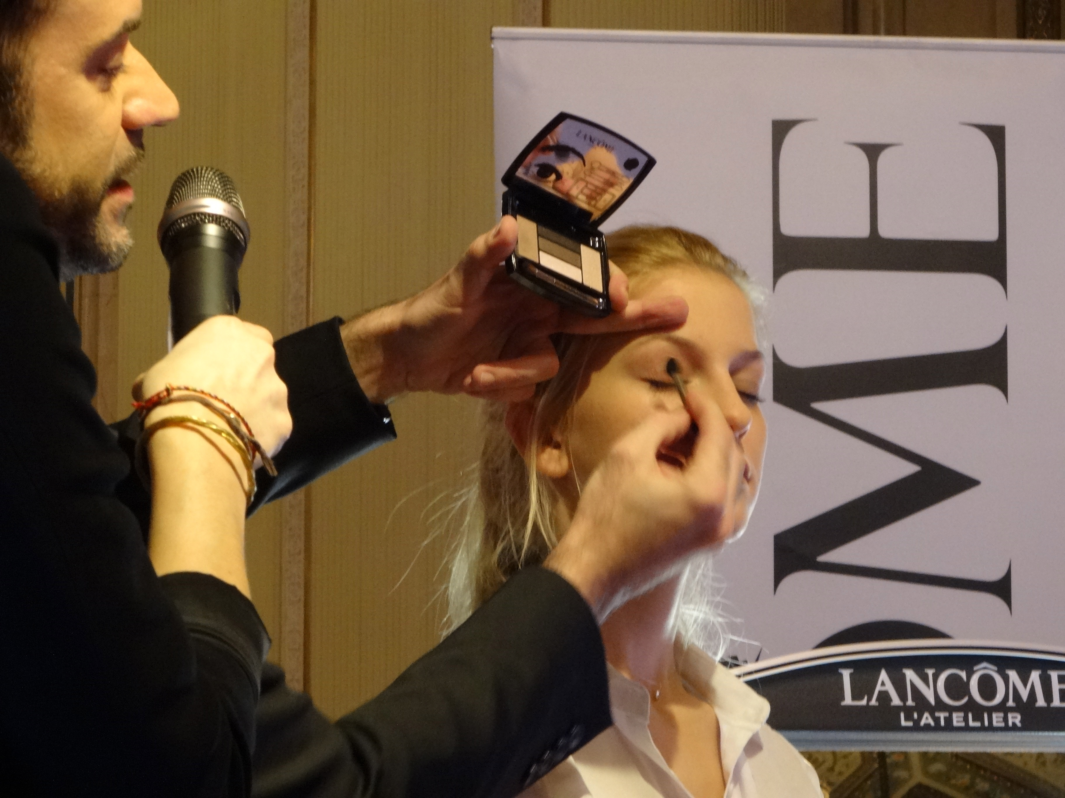 Lancome National Makeu-up Artist demonstrating eyeshadow