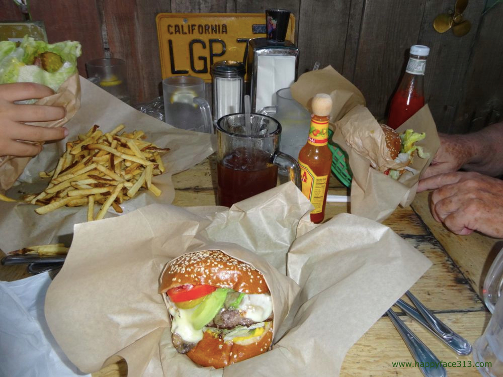 savoring delicious burgers and freshly made fries