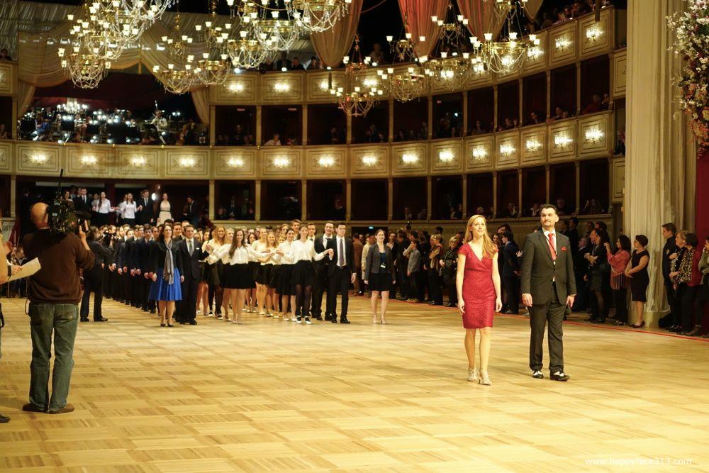 dance instructors Roman & Elisabeth Svabek and debutantes entering